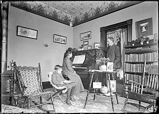 VPL #7118, Philip Timms, 190-, First family in living room in New Westminster